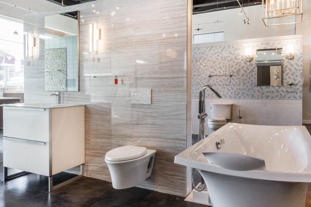 bathtub, toilet, vanity and fixtures on display in a Bender Showroom