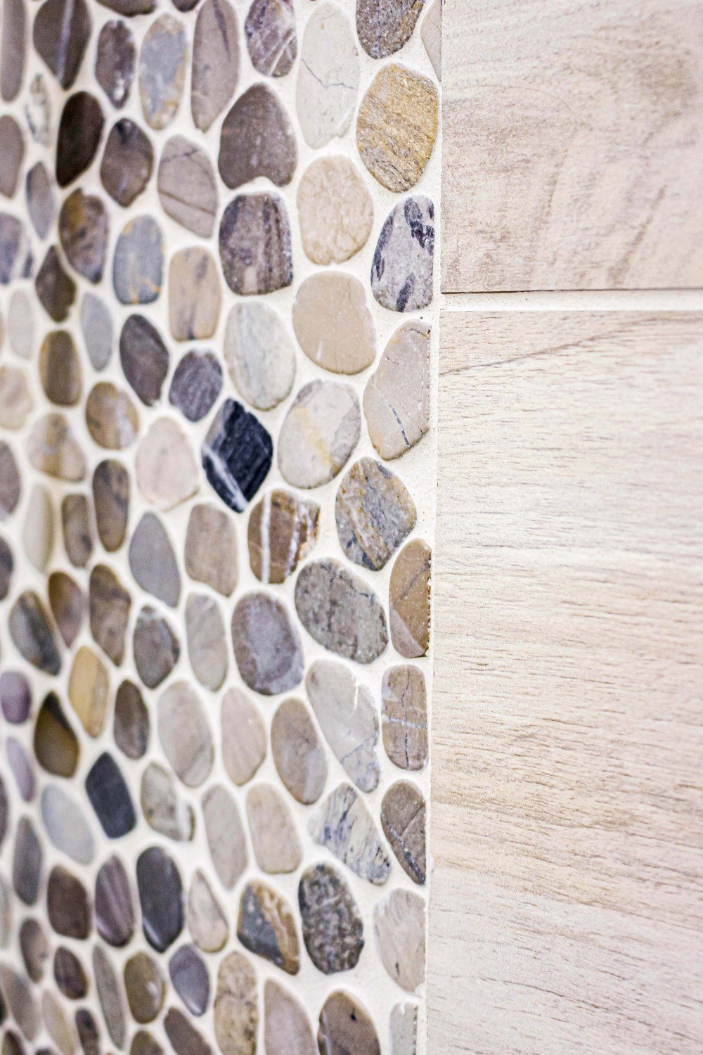 multicolored stone and beige wood tile