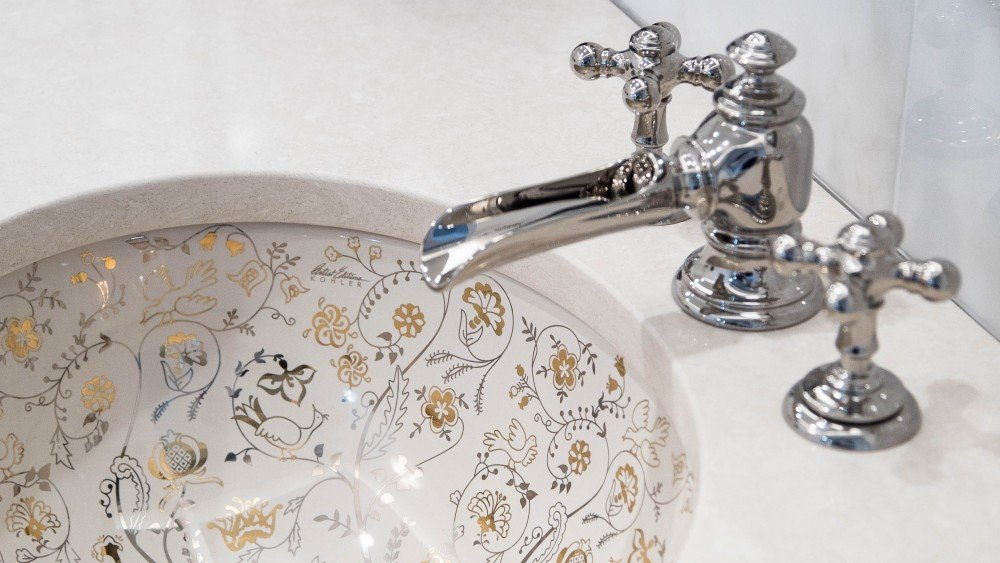 silver and gold hand-painted sink by Kohler