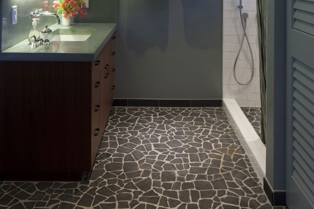 bathroom floor with dark grey stone tile and white grout