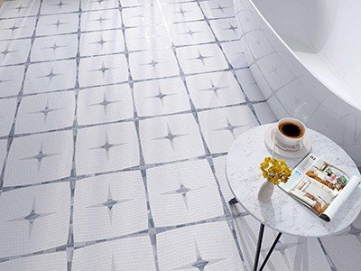 white and grey star patterned tile